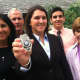 New Officer Kelly Coughlin holds her New Canaan Police Department badge, joined by his mother Laura, father Tim, brother TJ and grandmother Joan.