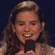 """Mamaroneck's Carly Rose Sonenclar, smiling after a performance on """"X Factor."""" She received the second-most viewer votes Thursday night."""