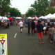 The crowd checks out the various tents at New Canaan's sidewalk sale Saturday.