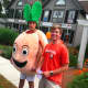 Someone's gotta do it: On a warm, muggy morning these two young men are promoting Peachwave frozen yogurt.