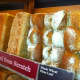 """Part of the """"wall of bread"""" at the new COBS Bread bakery in Stamford."""