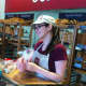 COBS Bread associate Kate Donohoe helps out a customer.