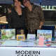 Zinka Benton, left, and Fran Rzeznik hosted a booth for their business, Modern Family Real Estate, at New York City Pride week in June.