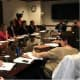 Federal Monitor Jim Johnson (far end of table) meets with Westchester County legislators.