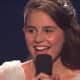 """Carly Rose Sonenclar smiles as """"X Factor"""" judges praise the 13-year-old Mamaroneck resident's performance."""