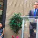 Gov. Dannel P. Malloy speaking at the official opening of the apartment building at 66 Summer St. Sitting at left is Maixuan Phan, a senior project manager for property developer Trinity Financial.