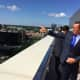 Gov. Dannel P. Malloy pointing out landmarks in downtown Stamford from the rooftop-deck at 66 Summer St.