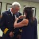 New Assistant Chief of Stamford Police Tom Wuennemann watches as his wife Jamie pins his badge on during the swearing in ceremony Wednesday.