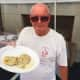 Yes, pierogies were on sale at the Polish Harvest Festival at Holy Name of Jesus Church on Sunday. Volunteer Al Koproski holds the plate.