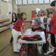 Rye Middle School students learn about various types of families at one of the booths set up for the Diversity Expo.