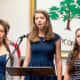 Students sing during the May 30 Memorial Day tribute in Pleasantville.