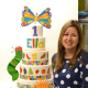 Renata Papadopoulos, owner of Lovely Cakes in Stratford, stands by a masterpiece cake she created for a child's first birthday.