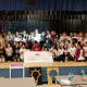 Ramaswamy, kneeling bottom left, and the 75 tri-state area girls at the STEAM-A-THON event.