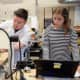 Bronxville Middle School technology teacher Greg Di Stefano helps a student use a woodcarving machine to create a board game.