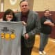 Coach Bob Cimmino celebrates his 500th win as Mount Vernon High School's head varsity boys' basketball coach with his cousin Joanne Lederer.