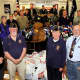Members of American Legion Post 162, vets, accept donations.