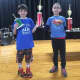 Reese Axelrod, left, and Daniel Babayev, members of Ward Checkmates, celebrate their wins in a recent scholastic contest at the William B. Ward Elementary School in New Rochelle.