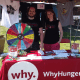 "Two representatives from WhyHunger promote their cause of, ""food justice,"" at the festival."