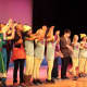 "The ensemble performs a dance at the Peekskill Middle School performance of ""Willy Wonka, Jr."""