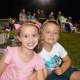 Charlotte Lucca and her friend Alek Ortiz are all smiles waiting for the fireworks to start.