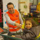 Yavuz Aydin, the director of the Turkish Cultural Center in Palisades Park, volunteers at a food collection event.