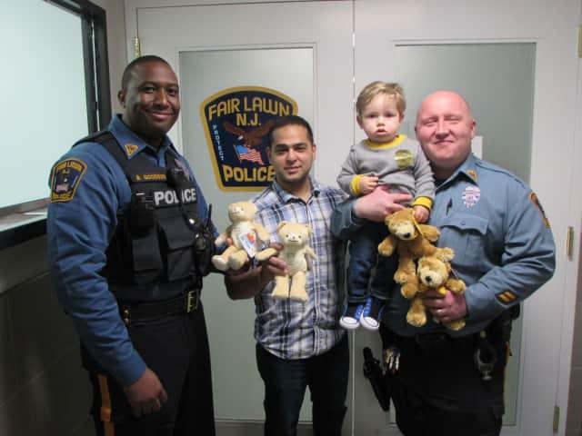 From left: Officer Brian Goodson, Rishi Ramchandani, James Redzia & Officer Eric Eleshewich