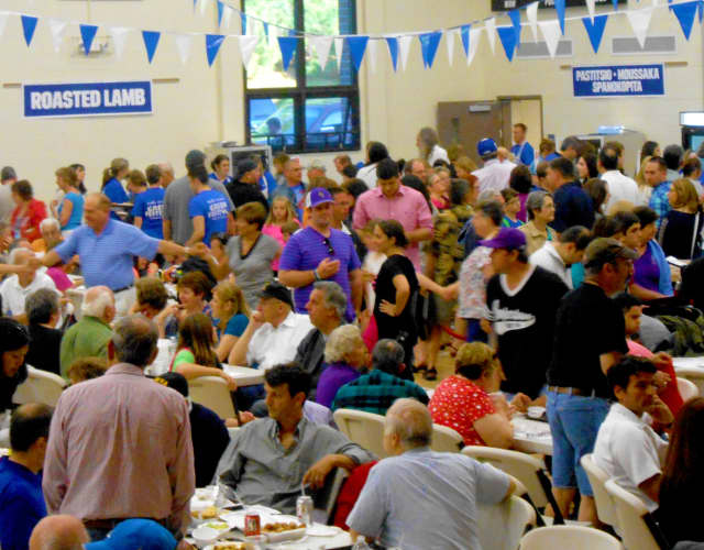 Festival-goers enjoy food and games under the big tent during last year's event.