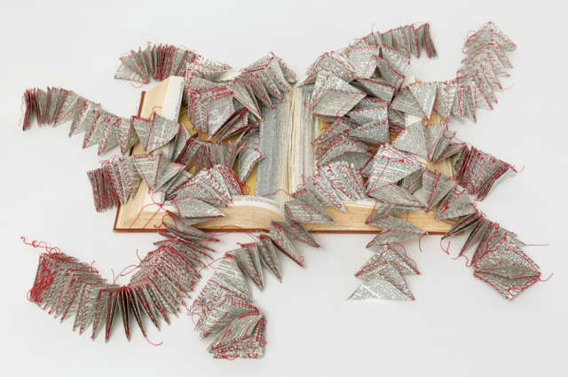 """Swiss-born Vivian Rombaldi Seppey's """"Flying Words"""" (2014), made of dictionary and thread, is one of the many thought-provoking words in the touring exhibit """"Freed Formats: The Book Reconsidered."""""""