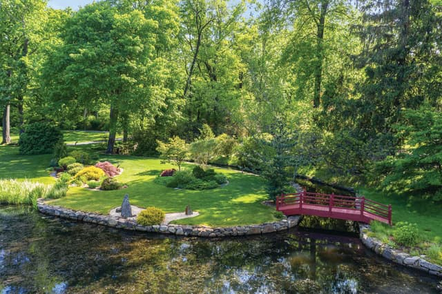 This Tudor-style estate (opposite) – the former home of Michael Bakwin, a supporter of the New York Botanical Garden and the Brooklyn Botanic Garden – features magnificent landscaping, including this Japanese rock garden. Courtesy Daniel Milstein Photography.