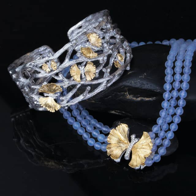 A Michael Aram butterfly ginkgo cuff bracelet with diamonds in sterling silver and 18-karat gold, $2,175, pairs beautifully with his butterfly ginkgo triple strand necklace with chalcedony and diamonds in sterling silver and 18-karat gold, $2,250.