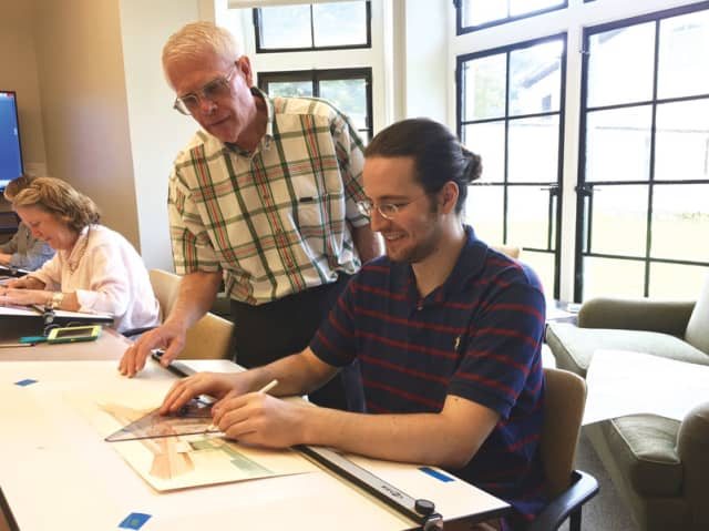 Professor Robert Hardy with student Timothy Beaupre. Photograph by Elizabeth Hastings.