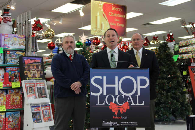 County Executive Rob Astorino makes a push for shopping locally during his appearance Wednesday, Nov. 25, in Eastchester. He is flanked by Will Humphries, of Eastchester's Value Drugs, and Eastchester Supervisor Anthony Colavita.