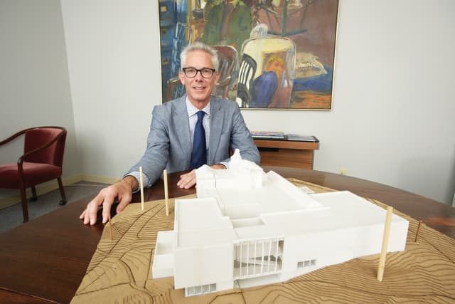 Robert Wolterstorff with a model of what the Bruce Museum will look like following renovations. Photograph by Bob Rozycki