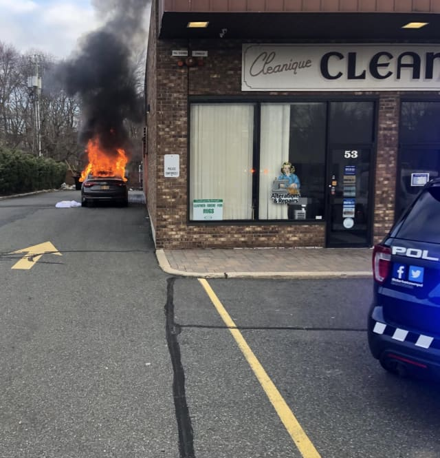 A car fire at a Rockland shopping center destroyed the vehicle and damaged one business.