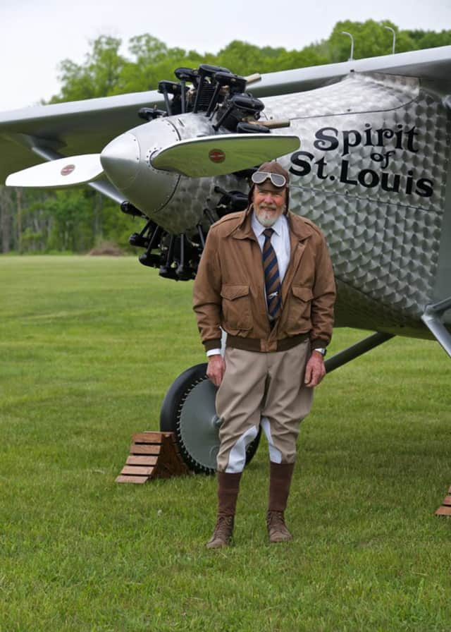 The pilot with the replica plane.