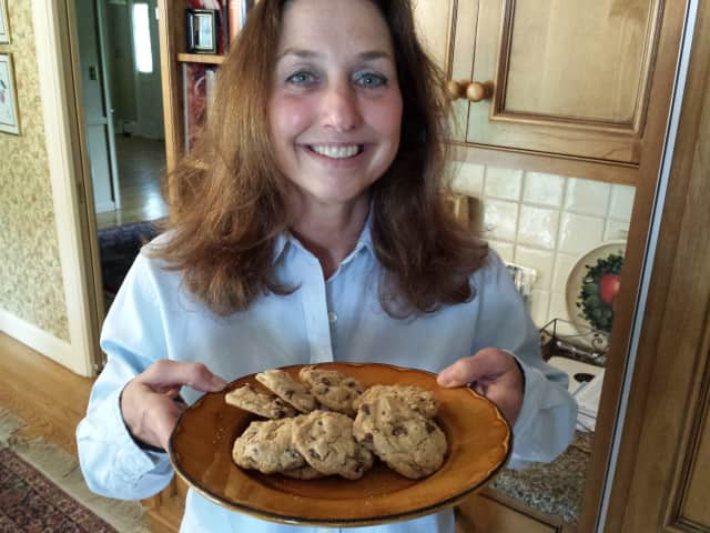 """Annalise Roberts holds a batch of her own chocolate chip cookies. She is the author of four books, including the recent """"Gluten-Free Baking Classics: The Heirloom Collection."""""""