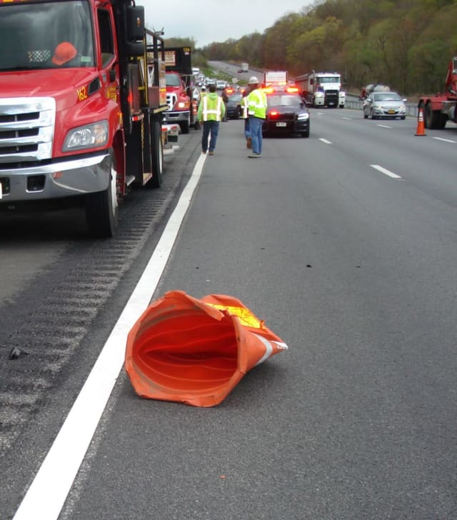 A 41-year-old highway worker was injured after being by a pickup truck.