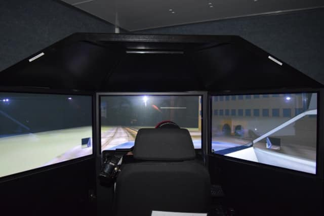 A Fox Meadow High School student takes a virtual drive home, using Westchester County's drunk driving simulator. The simulator was brought to the campus by the county Department of Public Safety.