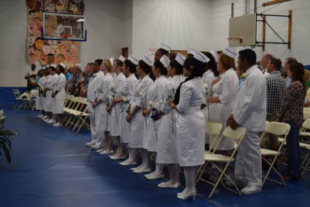 The graduates of the BOCES nursing program line up for commencement.