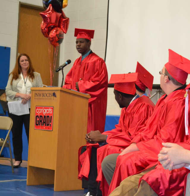 Fox Meadow Graduation Davonte Hudson: Davonte Hudson delivering the Senior Comments at Fox Meadow High School's graduation ceremony at PNW BOCES in Yorktown Heights as Principal Nicole Murphy looks on.