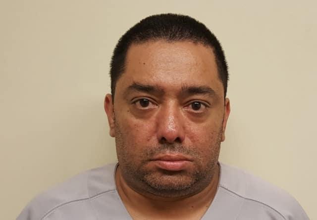 Hector Santos, Jr. of Garfield, 41.