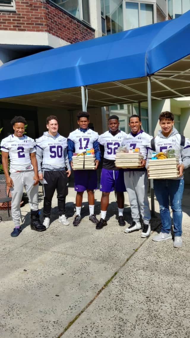 Players from the New Rochelle Varsity football team delivering meals to patients at Montefiore Hospital.