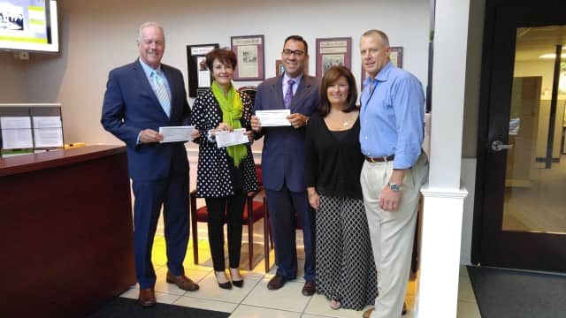 Representing this year's beneficiaries, from left, are Raymond Baldwin, Jr., Dianne Auger, Joseph Pagliaro, Jr., Rosemarie Esposito and Robert Lesko.