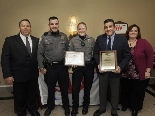 AAA Danbury Branch Manager Christine Lucsky, right, presents the awards to, from left, Newtown Police Lt. Chris Vanghele, police officer Ben Mulhall;  police officer Paul Wickman with her award; and Newtown Police Chief James Viadero.