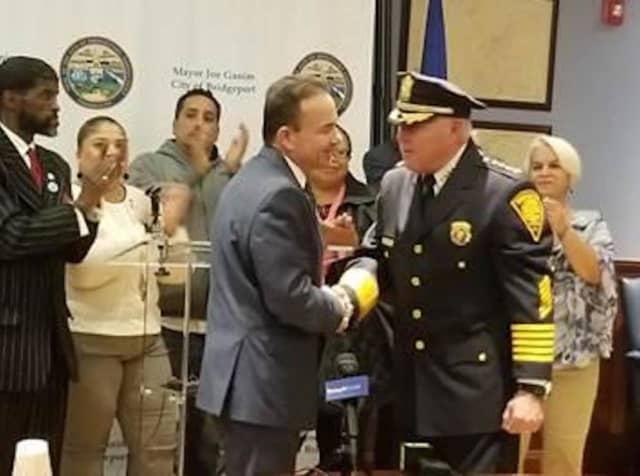 Mayor Joe Ganim congratulates new police Chief AJ Perez.