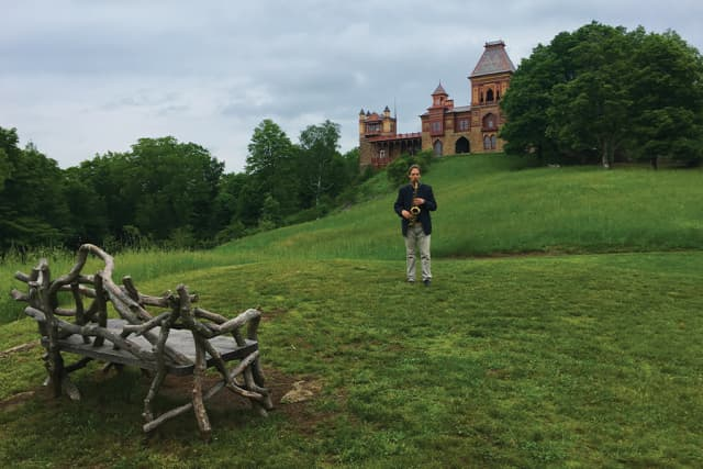 Christopher Brellochs and his saxophone at Olana State Historic Site in Hudson. Photograph by Wade Nobile.