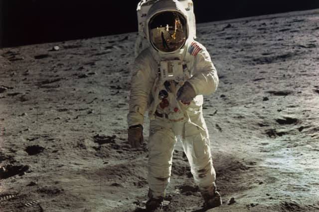 """""""Buzz Aldrin Walking on the Surface of the Moon Near a Leg of the Lunar Module"""" by Neil Armstrong of Apollo 11 (1969), dye transfer print (printed later). Part of The Metropolitan Museum of Art's """"Apollo's Muse: The Moon in the Age of Photography"""" (July 3-Sept. 22). Copyright The Metropolitan Museum of Art."""