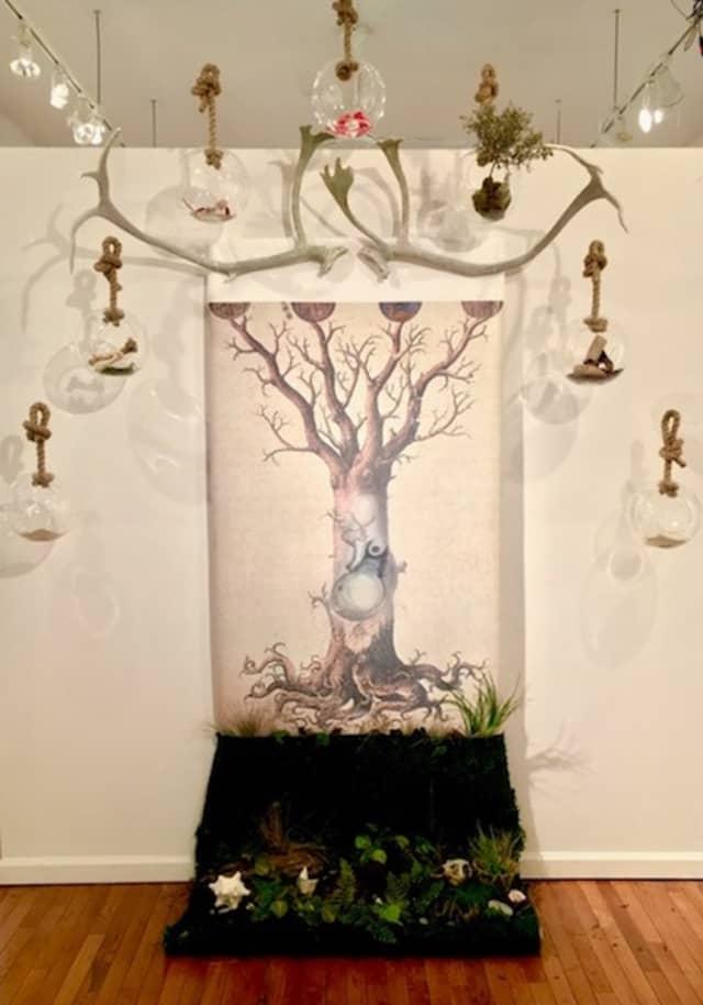 """Elizabeth Arnold, """"Alchemy."""" Installation: glass, ash, bark, wood, bone, flower, compost. Courtesy BAU Gallery."""