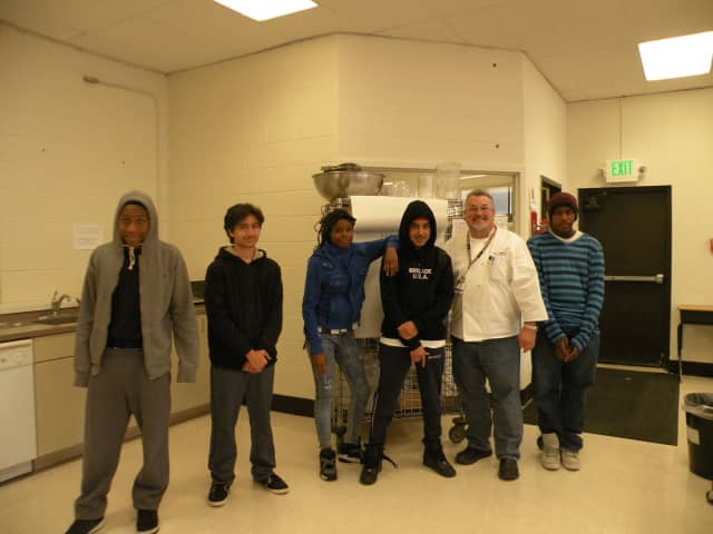 """""""Cheffy"""" Stanley Rupinski with students of his culinary class at Fox Meadow Middle/High School."""