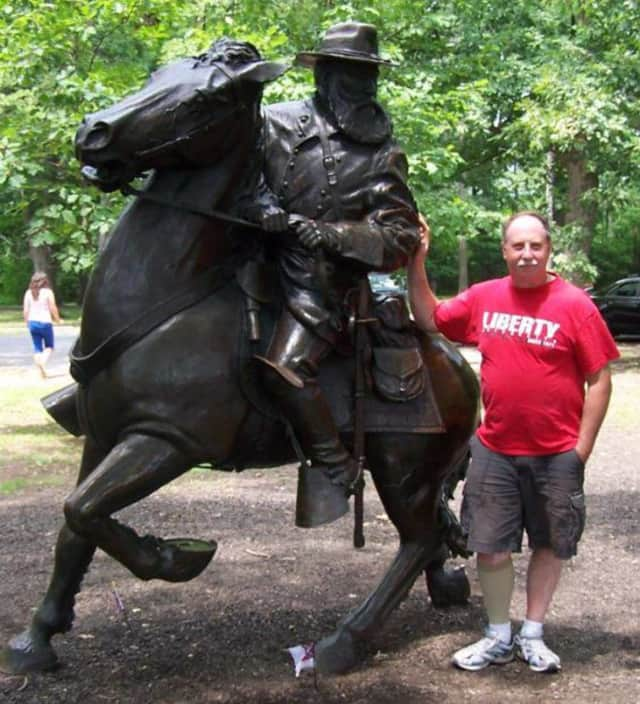 Tim Adriance -- here standing with a statue of his cousin, General James Longstreet, at Gettysburg -- will be honored with a lifetime achievement award for historic preservation.